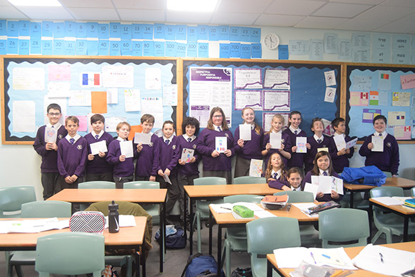 Year 7 students receive cards from French penpals.